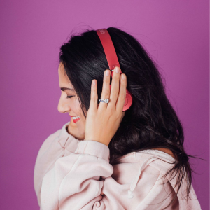 Girl Listening to Headphones & Smiling Cropped 500x500-01